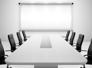 3D render of meeting room with projection screen and conference table